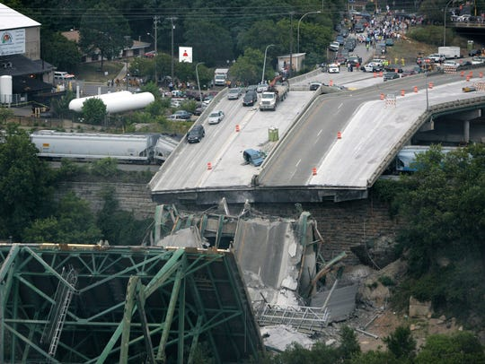 Collapsed sections of the Interstate 35W bridge lie