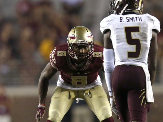 FSU's Jalen Ramsey eyes up Texas State wide receiver Brandon Smith during their game at Doak Campnbell Stadium on Saturday.