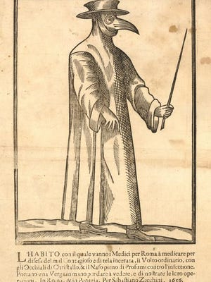 This print of a woodcut shows a plague doctor in Rome dressed in a long coat, wearing gloves, a flat, broad-rimmed hat, glasses, and a bird-like mask with a long beak.