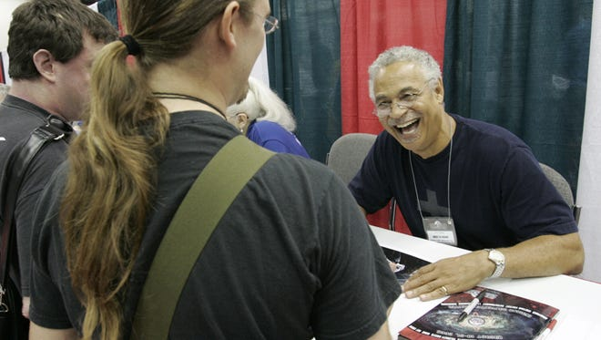Actor Ron Glass, shown signing autographs during GenCon in 2005, will appear at Indy PopCon May 30-June 1.