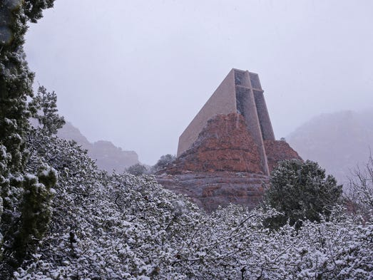 Snow begins to accumulate near the Chapel of the Holy