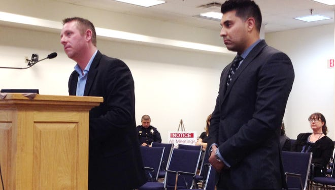 Audit Manager Geoff Mamerow, left, and auditor Daniel Trujillo, from Kubiak Melton & Associates in Albuquerque, discuss the 2014-15 audit with the Silver City Town Council on Tuesday.