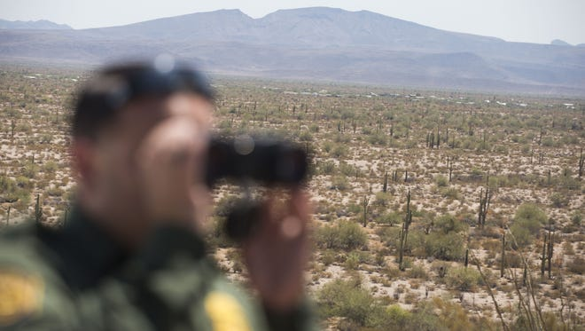 U.S. Border Patrol Agent Daniel Hernandez looks out for traces of a person who was illegally crossing the U.S. border near Ajo.
