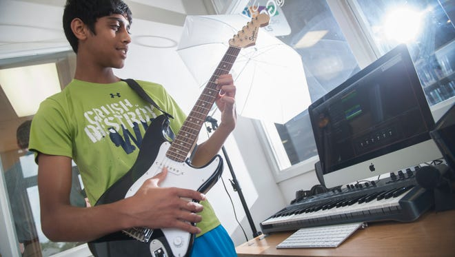 14-year-old Ayush Patel of Mullica Hill tries out the digital studio for creating and recording music in the MakerStudio@GCLS in the Gloucester County Library in Mullica Hill.