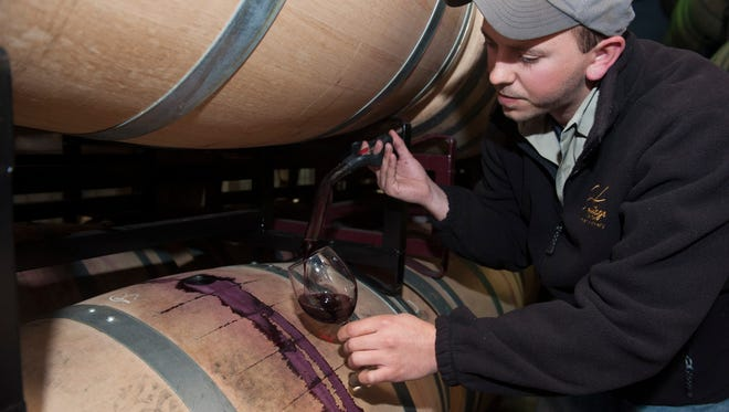 Rich Heritage samples wine at William Heritage Winery in Mullica Hill.