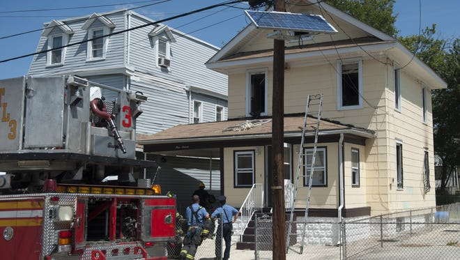 Scene from a fire on 31st St. near the intersection of Hayes Ave. in Camden. Monday, August 18, 2014.