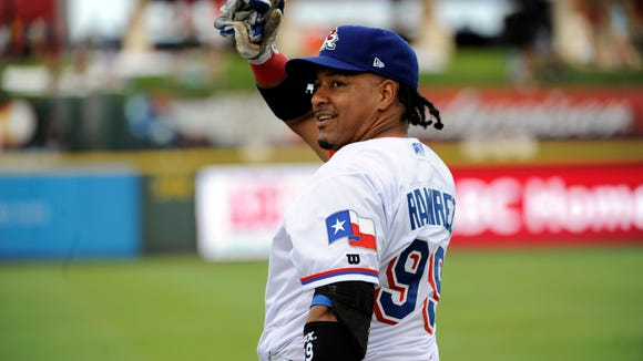 Round Rock Express designated hitter Manny Ramirez greets fans before a game in July of 2013.