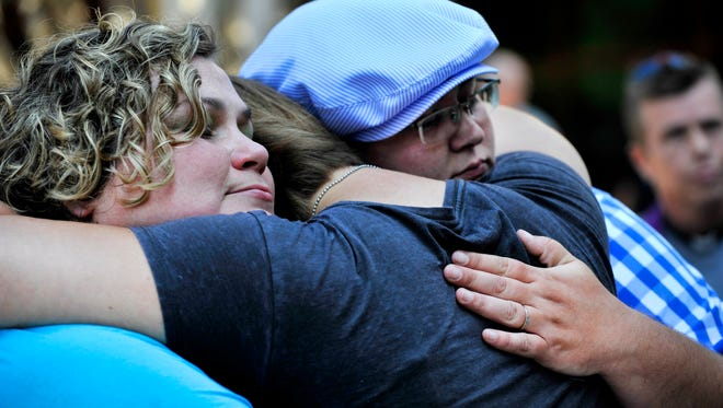 Ivey Hill and Misha Gibson, one of six lesbian, gay, bisexual or transgender couples applying for a license to marry at Greenville County Probate Court at County Square, are consoled by friend Emily McSherry after being denied their license on Wednesday, July 30, 2014.