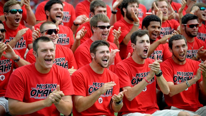 """UL baseball players react to receiving a sixth overall seed in the NCAA baseball tournament while watching the selection show at M.L. """"Tigue"""" Moore Field in Lafayette, LA, Monday, May 26, 2014. UL will host an NCAA Regional and potentially an NCAA Super Regional in Lafayette.   Paul Kieu, The Advertiser"""