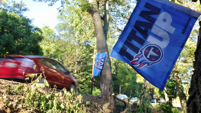 Flags mark the spot on Battery Lane and Dustin Lane where Rob Bironas' fatal car accident occurred.