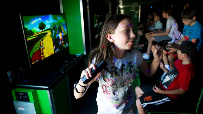 Hannah Mills, 11, plays with a Wii during the grand opening for Level Up Curbside Gaming in Spanish Springs on June 28.