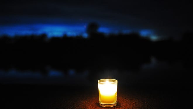 File photo of a lone candle