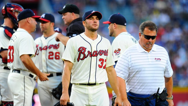Braves pitcher Brandon Beachy will miss the 2014 season with a torn elbow ligament. But he was the highest-priced player in 2014 AL Tout Wars in one of the strangest auctions in league history.