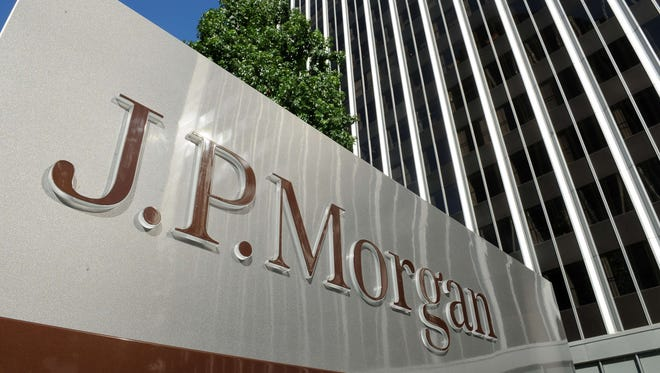 A JPMorgan sign is seen outside the office tower housing the financial services firm's Los Angeles, California offices.