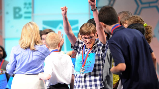 Dylan O'Connor celebrates advancing to the semifinals of the 2014 Scripps National Spelling Bee.