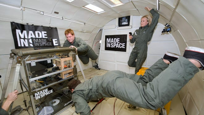 This undated photo provided by Made In Space shows a 3-D Printer during testing in the Microgravity Science Glovebox (MSG) Engineering Unit at Marshall Space Flight Center.