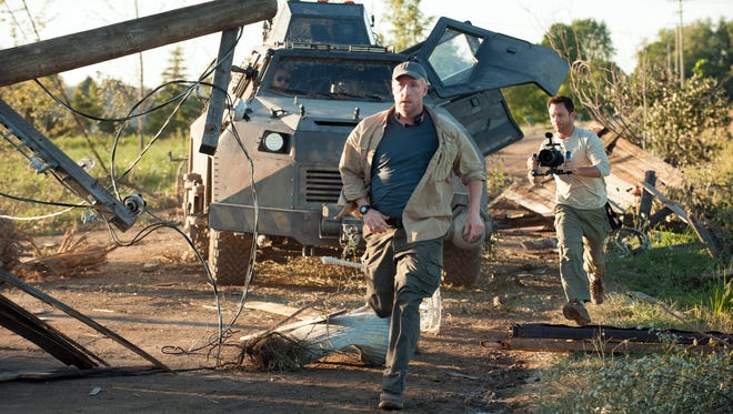 """Matt Walsh as Pete and Lee Whittaker as Lucas in a scene from the motion picture """"Into the Storm."""""""