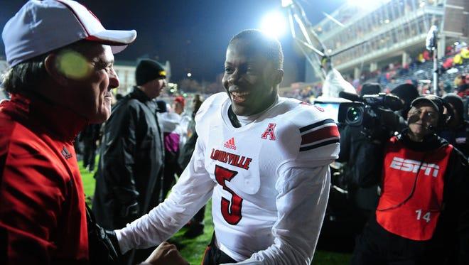 Louisville Cardinals quarterback Teddy Bridgewater (5) celebrates with fans after defeating the Cincinnati Bearcats 31-24 at Nippert Stadium.