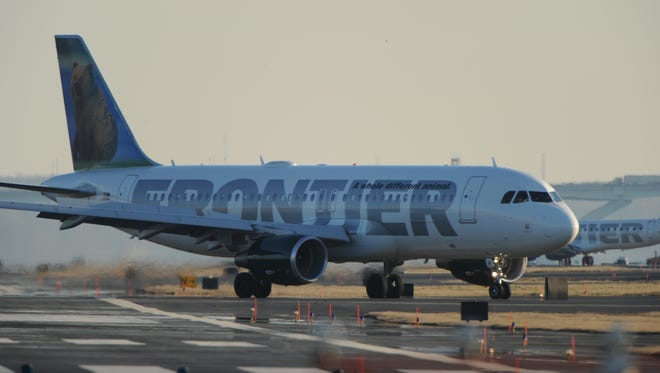 A Frontier Airlines jet taxis at Washington's National Airport on Feb. 9, 2012.