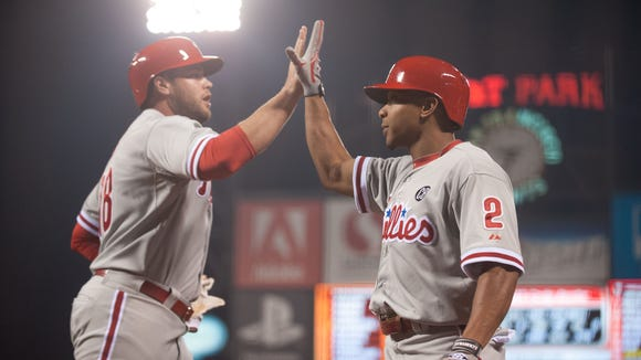 Philadelphia Phillies left fielder Darin Ruf (18) and center fielder Ben Revere (2) celebrate after scoring against the San Francisco Giants during the eighth inning Friday at AT&T Park. Credit: Ed Szczepanski-USA TODAY Sports