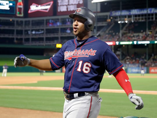 Minnesota Twins' Jonathan Schoop celebrates as he walks up to the dugout after hitting a two-run home run off Texas Rangers' Mike Minor during the seventh inning of a baseball game in Arlington, Texas, Friday, Aug. 16, 2019. The shot scored Marwin Gonzalez. (AP Photo/Tony Gutierrez)
