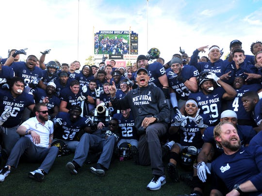 Nevada celebrates after defeating UNLV to win the battle