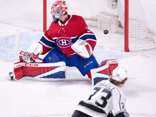 Los Angeles Kings center Tyler Toffoli (73) scores on Montreal Canadiens goalie Carey Price (31) during the first period of an NHL hockey game, Thursday, Oct. 26, 2017 in Montreal. (Ryan Remiorz/The Canadian Press via AP)