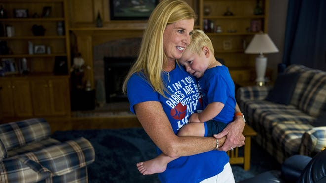 Angela Farnan holds her son, Blaze, who has a congenital heart disease, in their Peoria home Tuesday, September 1, 2020. Farnan is an organizer of the inaugural Heart of Illinois Congenital Heart Disease Walk slated for Sunday.