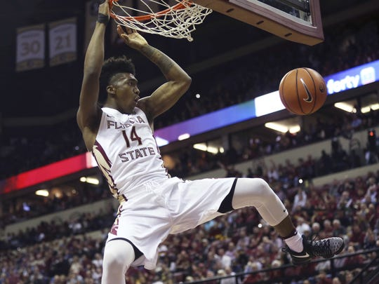 Florida State's Terance Mann (14) dunks the ball against Duke during the first half of an NCAA college basketball game, Tuesday, Jan. 10, 2017 in Tallahassee, Fla.