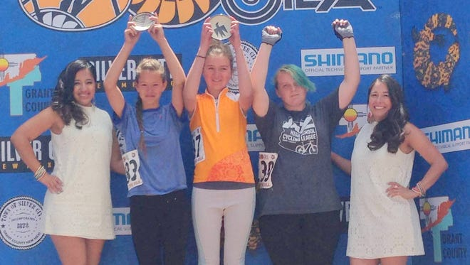 Sunday's citizen's Race winners for girls include, from left, Kenya Leahy, Ava Bjornstad, and Virginia Burgess.
