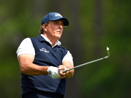 Phil Mickelson hits his tee shot on the 12th hole during the second round of the Masters golf tournament at Augusta National Golf Club.