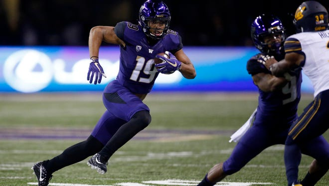Washington Huskies receiver Hunter Bryant (19) runs after the catch against the California Golden Bears during the second quarter of Saturday's game.