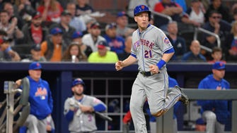 Apr 20, 2018; Atlanta, GA, USA; New York Mets third baseman Todd Frazier (21) scores a run against the Atlanta Braves during the fourth inning at SunTrust Park.