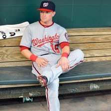 Jul 9, 2014; Baltimore, MD, USA; Washington Nationals outfielder Nate McLouth (15) prior to a game against the Baltimore Orioles at Oriole Park at Camden Yards. The Nationals defeated the Orioles 6-2. Mandatory Credit: Joy R. Absalon-USA TODAY Sports