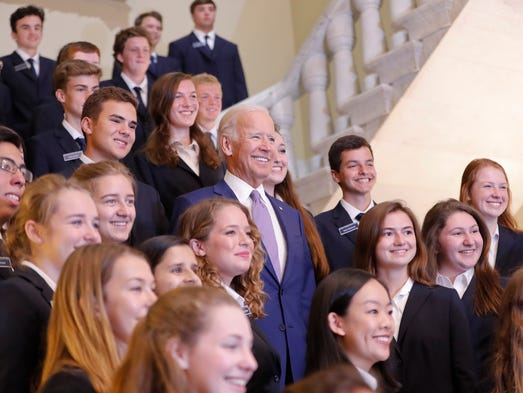 Biden poses for a photo with congressional pages on