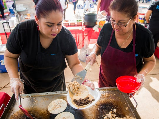 Mangonadas del Barrio cooks Maribel Martinez, left, and Deye Esquivel, right, of Detroit prepare tacos during the Latino/Hispanic Celebration at the Ford Resource and Engagement Center in southwest Detroit on Saturday, Sept. 9, 2017. The event included performances of folk music and dance as well as mexican food and family activities.