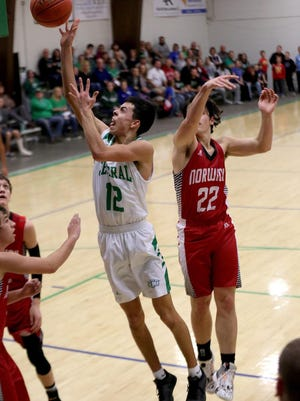 Central's Adre Ibarra Hall (12) shoots past Norwich's Bradey McIntire (22) during their game Friday evening, Jan. 17, 2020. Central defeated Norwich 58-40. Ibarra scored 19 points in the game.