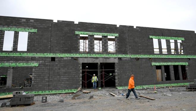 Construction crews work on Jordan Elementary, a new school on Split Log Road in Brentwood.