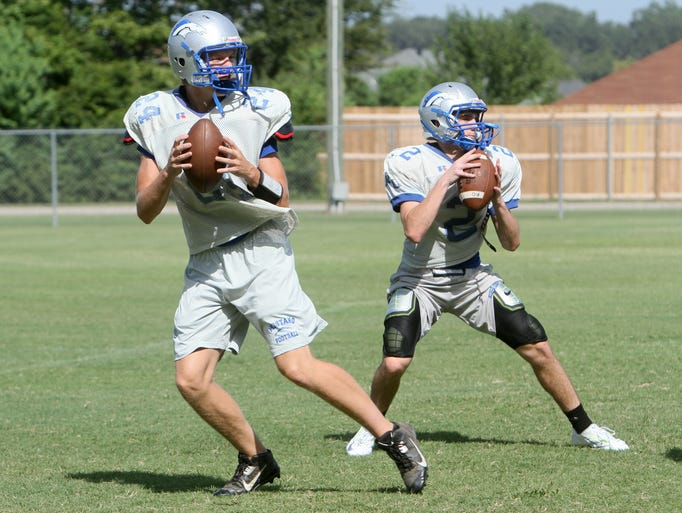 The River Oaks High School football team hits the practice field on Wednesday, Aug. 20, 2014.