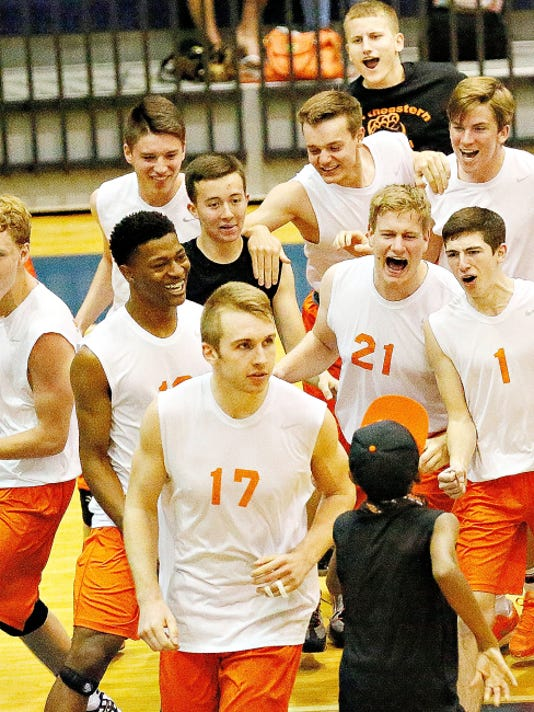 The Northeastern players celebrate their 3-0 win over Central York in the York-Adams League boys' volleyball title match on Tuesday at Dallastown High School.
