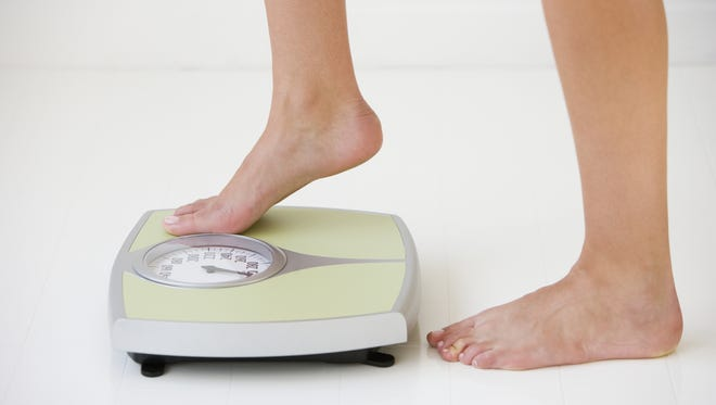 Stepping on to a scale.