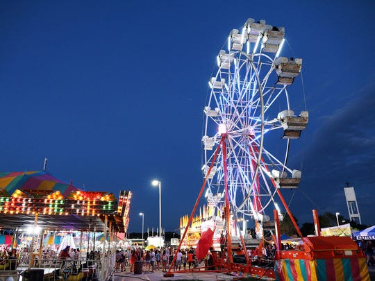 Guests ride the Ferris Wheel during SummerFest on Friday,