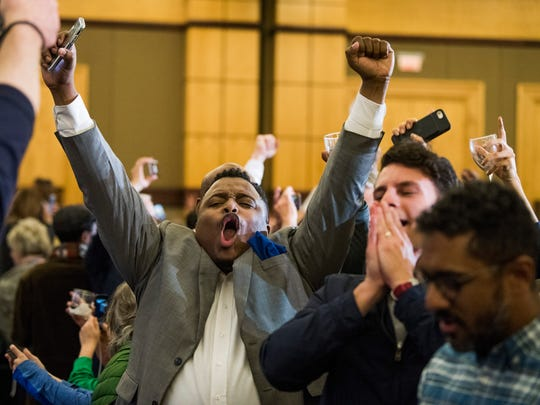 Supporters celebrate as U.S. Senate candidate Doug Jones is declared the winner at his watch party in Birmingham, Ala. on Tuesday December 12, 2017.