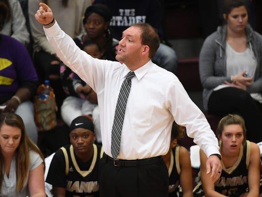 Hanna coach Glenn Elrod communicates with his team