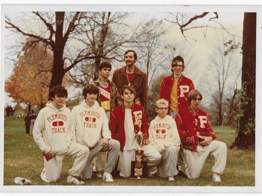 Members of Plymouth's 1971 state champion cross country team were, front row, left to right: Larry Bowman, Ken Lucas, Tim Nesbitt, Steve Adams, Brad Buzard. Back row: Mike Adams, coach Bob James, Jim Sutter