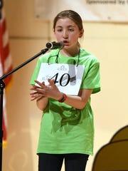 Maya Matava of Salisbury Middle School spells the championship