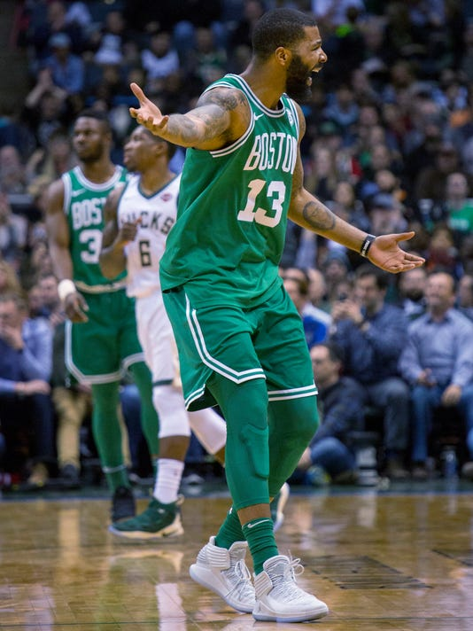 Boston Celtics forward Marcus Morris looks for a foul call after driving to the basket against the Milwaukee Bucks during the second half of an NBA basketball game Tuesday, April 3, 2018, in Milwaukee. (AP Photo/Darren Hauck)
