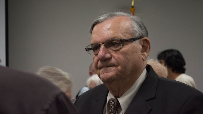 Joe Arpaio talks to attendees of a meeting of the Surprise Tea Party in Surprise, Arizona on September 20, 2016. The former Maricopa County sheriff's criminal-contempt trial began Monday, June 26.