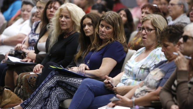 More than 100 people signed up to speak at a FDC public hearing held Tuesday at the Betty Easley Center to discuss proposed rule changes that could reduce visitation hours for inmates. Wives, girlfriends and parents of inmates spoke about the personal significance of their visits with incarcerated loved ones.