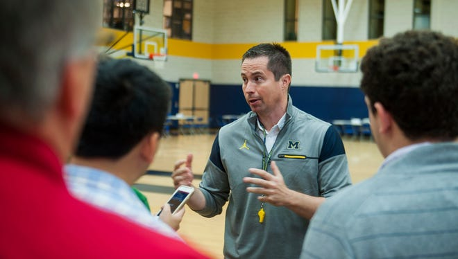 Assistant coach Billy Donlon answers questions during Michigan Wolverines men's basketball media day in Ann Arbor on Oct. 3, 2016.